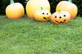 Clay sculpture pumpkins on the grass.  Halloween Royalty Free Stock Photo
