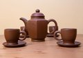 Clay teapot and cups Stock Photography
