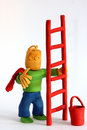 Clay workman with ladder Royalty Free Stock Images