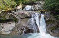 Clayton falls bella coola bc canada crystal clear water running over rocks in the forest Stock Photography