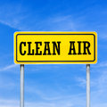 Clean air written on yellow street sign Royalty Free Stock Photography