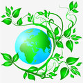 Clean ecology earth planet entwined with green branches and leaves Royalty Free Stock Photos
