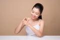 Clean fresh skincare concept. Young asian woman touching enjoyin Royalty Free Stock Photo