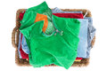 Clean fresh washed summer clothes in a basket neatly folded and viewed from above with colorful green shirt on top of the pile Stock Photo