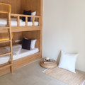 Clean hostel room with wooden bunk beds. Royalty Free Stock Photo