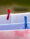Clean laundry with clothespins on clothesline housework wet towels hanging to dry the line outdoor rural scene Royalty Free Stock Image