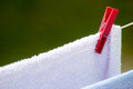 Clean laundry with clothespins on clothesline housework wet towels hanging to dry the line outdoor rural scene Stock Photo
