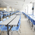 Clean school cafeteria with many empty seats and tables Stock Photography