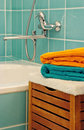 Clean towels in the bathroom front of faucet Stock Image