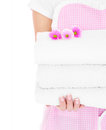 Clean towels a midsection of a woman holding a heap of and flowers Royalty Free Stock Image