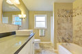 Clean and warm bathroom interior with marble tile