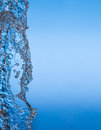 Clean water splash on blue background is a necessary condition for the existence of life on earth Stock Images