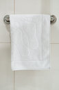 Clean white towel on a hanger prepared to use Royalty Free Stock Image
