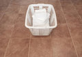 Clean white towels in a laundry basket Stock Images
