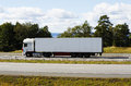 Clean white truck in motion on freeway close ups and sideways view Royalty Free Stock Photography