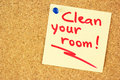 Clean your room sticker on the cork yellow pined corkboard Royalty Free Stock Photos