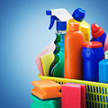 Cleaners supplies and cleaning equipment on a blue background Stock Image