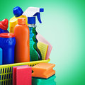 Cleaners supplies and cleaning equipment on a green background Royalty Free Stock Photography