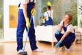 Cleaners sweeping floor Royalty Free Stock Photo