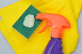 Cleaning bottle and fluid with sponge cloth Royalty Free Stock Photo