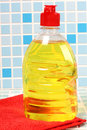 Cleaning bottle on tile protective and products background Stock Photo