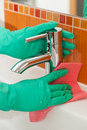 Cleaning broom a man with pink gloves an air grille with anorange Royalty Free Stock Images