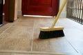 Cleaning broom on wooden floor