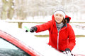 Cleaning the car a picture of a young woman a windshield from snow Stock Photography