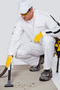 Cleaning cement floor with vacuum cleaner Stock Photos