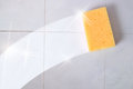 Cleaning concept trace sponge on a dirty wall tiles yellow gray horizontal composition Stock Photos