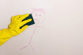 Cleaning crayon off wall with sponge Royalty Free Stock Photo