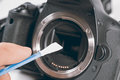 Cleaning dirty camera sensor. Digital photo camera with cleaning Royalty Free Stock Photo