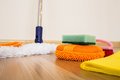 Cleaning equipment set of on a wooden floor Stock Image