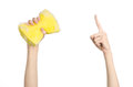 Cleaning the house and sanitation topic hand holding a yellow sponge wet with foam isolated on a white background in studio Royalty Free Stock Photography