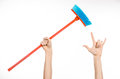 Cleaning the house topic: human hand holding a red broom Royalty Free Stock Photo