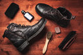 Cleaning of men s boots clean vintage with wax sponges and brushes Stock Photo