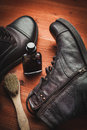 Cleaning of men s boots clean with wax sponges and brushes Royalty Free Stock Photo