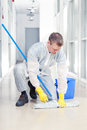 Cleaning office man wearing protective overalls Stock Photo