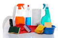 Cleaning products with cleaning material on white Royalty Free Stock Photo
