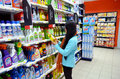 Cleaning products young woman selecting in a supermarket Stock Image