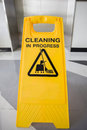 Cleaning in progress caution sign in office Royalty Free Stock Photo