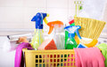 Cleaning supplies in basket in kitchen Royalty Free Stock Photo