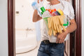 Cleaning supplies cropped image of man holding bucket full of Stock Photos