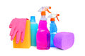 Cleaning supplies on white background including several spray bottles of chemicals rubber gloves and sponges Stock Photos