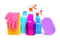 Cleaning supplies on white background including several spray bottles of chemicals rubber gloves and sponges Royalty Free Stock Images