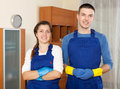 Cleaning team in uniform man and women is ready to work Royalty Free Stock Photography