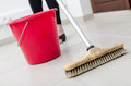 Cleaning of tiled floor with broom brush Royalty Free Stock Photo