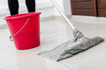 Cleaning of tiled floor with floorcloth Stock Images