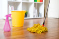Cleaning tools on parquet floor Royalty Free Stock Photo