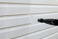 Cleaning the wall vinyl siding Royalty Free Stock Photo